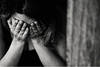 Black and white close up of a woman crying