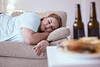 Woman sleeping on the couch because of lethargy due to addiction