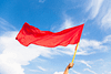 Close up of a person waving a red flag
