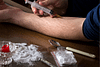 Close up of a man injecting drugs at a safe injection site
