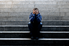 Young man sitting on stairs, suffering from opioid dependence